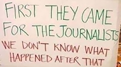 sign that says first they came for the journalists, we don't know what happened after that