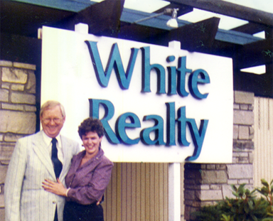 Norman and Olivia White in front of their office on Cornell (now occupied by the tax company)